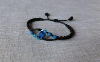 Bratara neagra cu pietre agate albastre.