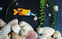 Brosa de arta The fish which had some orange juice